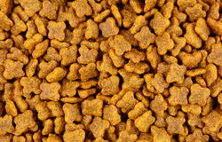 Close up of brown dog food Royalty Free Stock Images