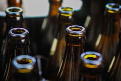 Close up of brown empty beer bottles in a case stock photos