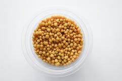 Brown fertilizer pellets on white background. Close up brown fertilizer pellets on white background Stock Image