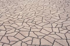 Brown or gray paving slabs in cracked natural patterns texture abstract for background stock photo