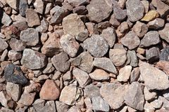 Brown and grey rocks on the ground. Close up of brown and grey rocks on the ground Stock Photography