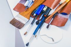 Close-up Brown leather case with brushes Stock Images
