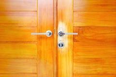 Close up brown modern wooden door Royalty Free Stock Photos