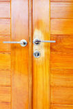 Close up brown modern wooden door Royalty Free Stock Images