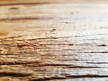 Close-up Old Wooden Table with Scraped Grainy Texture with Selective Focus. Close-up Brown Old Wooden Table with Scraped Grainy Texture with Selective Focus stock photography