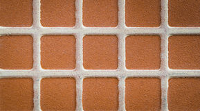 Close up brown square mosaic tile. Pattern and background Stock Image