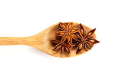 Close up the brown star anise spice in wooden spoon isolated on Stock Photography