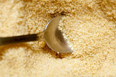 Close up brown sugar with spoon Royalty Free Stock Photos