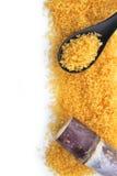Close up brown sugar and sugarcane Royalty Free Stock Image