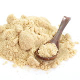 Close up of brown sugar on white background Royalty Free Stock Photo