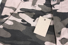 Close-up brown tone camouflage pocket shorts with tag (front) Stock Photography