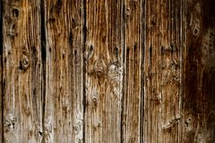 Brown wall made of wooden planks. Background for text royalty free stock image