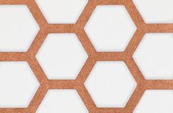 Close-up of brown and white hexagon pattern wallpaper background Royalty Free Stock Photos