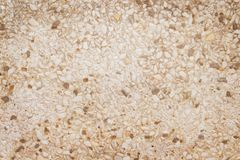 Close up brown or white mixed small rock patterns texture wall on background royalty free stock photos