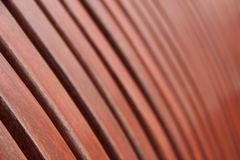 Wooden Planks Close Up Background. A close-up of the brown wooden planks of the bench in a park royalty free stock photos