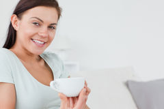 Close up of a brunette with a cup of coffee Royalty Free Stock Images