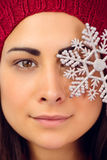 Close up of a brunette holding snowflake Stock Photography