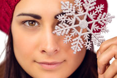 Close up of a brunette holding snowflake Royalty Free Stock Photography