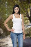 Close up of the brunette lady in a tank top. Stock Image
