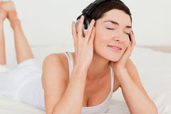Close up of a brunette listening to music Stock Photo