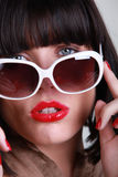 Close-up of brunette wearing sunglasses Stock Photography