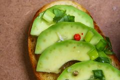 Close-up bruschetta with avocado, spices. Seasonal harvest crop local produce concept. Authentic lifestyle image. copy space, top royalty free stock photography