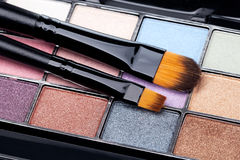 Brush and eye shadow Stock Photography