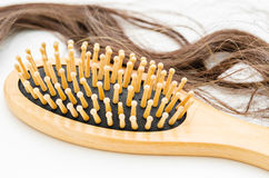 Close-up of a brush with lost hair on it. Royalty Free Stock Photos