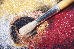 Close-up on brush and shining powder Stock Photos