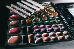 Close up. brushes and eye shadow. isolated on black. Background royalty free stock photos