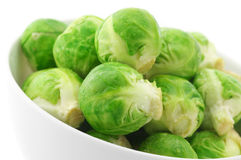 Brussels sprouts in bowl. Close-up of brussels sprouts in bowl on white background Stock Photos