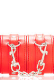 Close up of buckle belt on a BDSM leather red handcuffs. Isolate on white background and clipping path Royalty Free Stock Photography