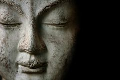 Close up Buddah statue with black copyspace. A Close up of a stone Buddah statue with black copyspace stock image