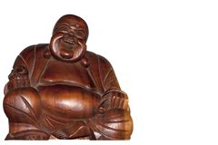 Close up Buddah statue with white copyspace. A Close up of a wooden laughing Buddah statue with white copyspace Royalty Free Stock Photo