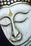 Close up Buddha face, Thai style wooden carving. Stock Photo