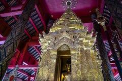 Close-up of Buddha image in golden pagoda at the main hall of Wat Prathat Lampang Luang, an ancient Buddhist temple in Lampang. stock photography