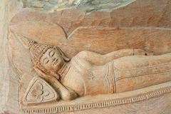 Reclining buddha image carving on wooden stock image