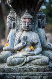 Close up buddhist statue Kathmandu Nepal. Close up of oblations of food and flowers to their gods on small statues , Kathmandu. Nepal, Asia royalty free stock photography