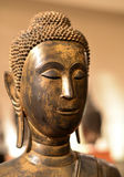 Buddhist statue head. Close-up with a Buddhist statue's head Stock Images
