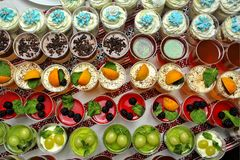 Close-up buffet table with fresh fruits jelly and cream. Weddin. G buffet with desserts stock photo
