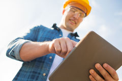 Close up of builder in hardhat with tablet pc Royalty Free Stock Photography