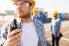 Close up of builder in hardhat with walkie talkie. Industry, building, technology and people concept - close up of male builder in hardhat with walkie talkie or Stock Photography