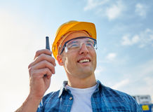 Close up of builder in hardhat with walkie talkie Stock Image