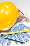 Close up of builder's tools - helmet, work gloves, hammer, pen a Royalty Free Stock Photography