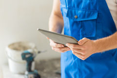 Close up of builder or workman with tablet pc Royalty Free Stock Image