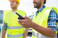 Close up of builders in vests with walkie talkie Stock Photos