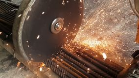 Close-up of the Bulgarian cuts metal in slow motion. Sparks fly out from under the wheel of the grinder in slow motion. 960fps stock video footage