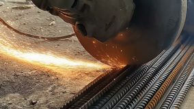 Close-up of the Bulgarian cuts metal in slow motion. Sparks fly out from under the wheel of the grinder in slow motion. 960fps stock video