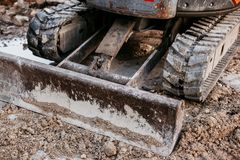 Close up of bulldozer working with soil on construction site royalty free stock image