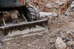 Close up of bulldozer working with soil on construction site stock photo